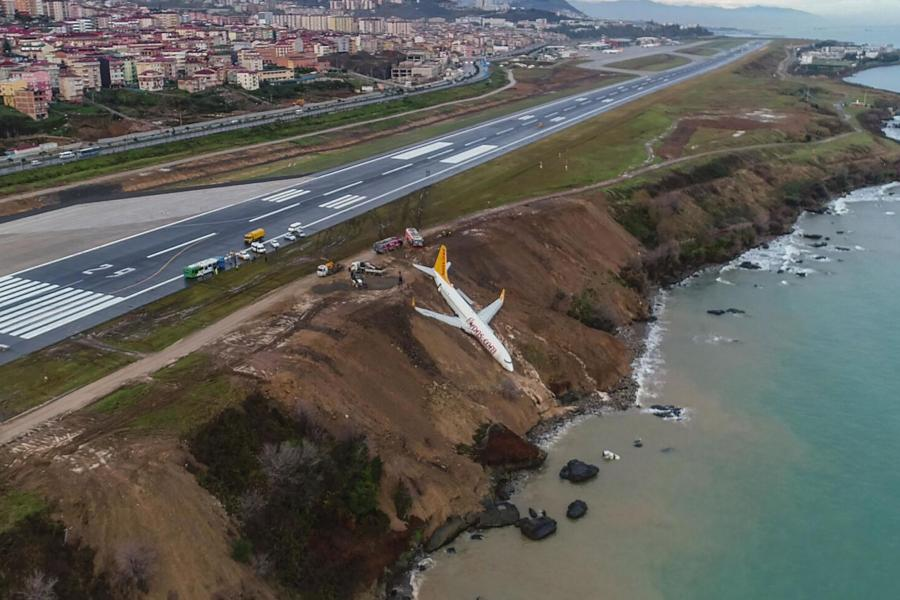 Passenger jet skids off runway and comes perilously close to plummeting into sea in Turkey